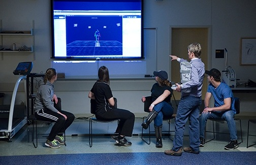 Heather Gulgin, associate professor of movement science, is pictured showing students images from the gait analysis lab.